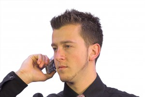 business man on the phone with a serious look